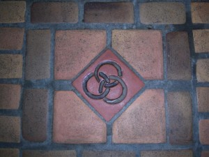 Photo by Bridget Blesnuk - Floor Tile with Trinity Symbol