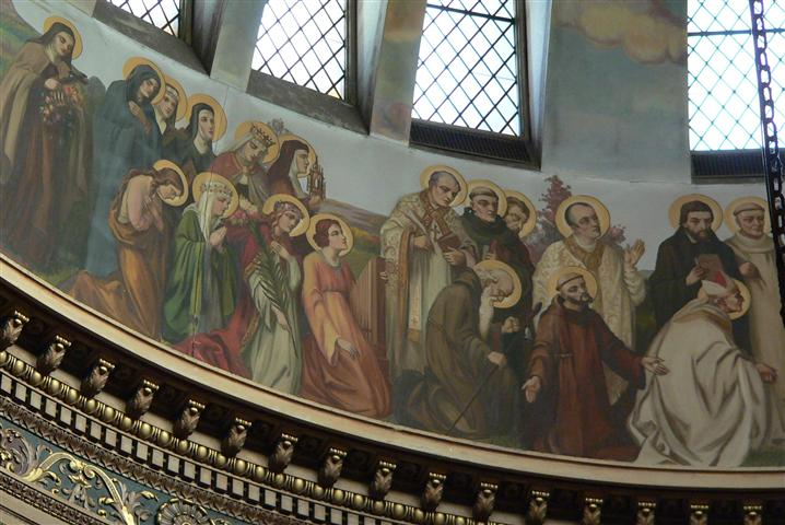 "St. Bernard of Clairbeaux (1090-1153) and St. Rose of Lima (1568-1617), whose feastdays we celebrate this week, are depicted in the dome of our church in a painting by Buffalo-born artist Joseph Mazur. St. Rose appears in a group of ten figures identified as ""Virgins and Widows""; she is the second kneeling figure from the left, wearing a green cloak and floral crown. St. Bernard appears in a grouping of ""Monks, Hermits, and Religious""; his figure is at the far right in this photo, robed in white. (Rev. Walter Kern's ""Guidebook to Blessed Trinity R. C. Church,"" p. 38. Photo credit: Gary Kelley."