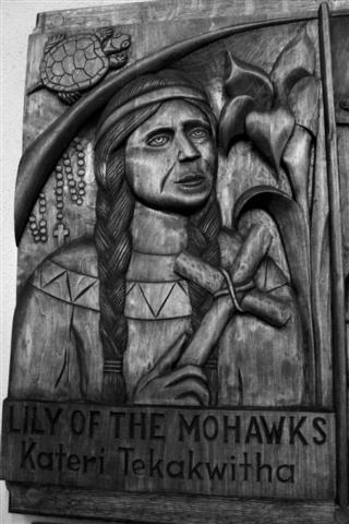 St. Kateri Tekakwitha July 14 Woodcarving, gift of the Southtowns Woodcarvers of WNY, on right (west) transept wall