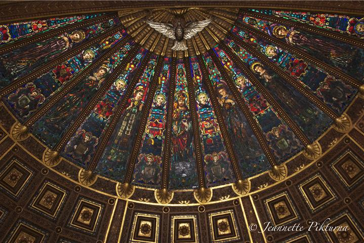 The theme of the church's skylight is Our Lord Jesus Christ, King of the Universe. The central panel shows Christ reigning as Lord of the kingdom that we pray will come. Photo credit: Jeanette Pikturna