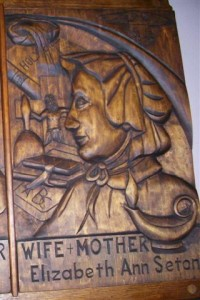 Our Altar of Sacrifice also contains a relic of St. Elizabeth Seton (1774-1821), the first saint born in the U.S. to be canonized. This woodcarving hangs on the left (east) transept wall. It is a gift of the Southtowns Wood Carvers of WNY.