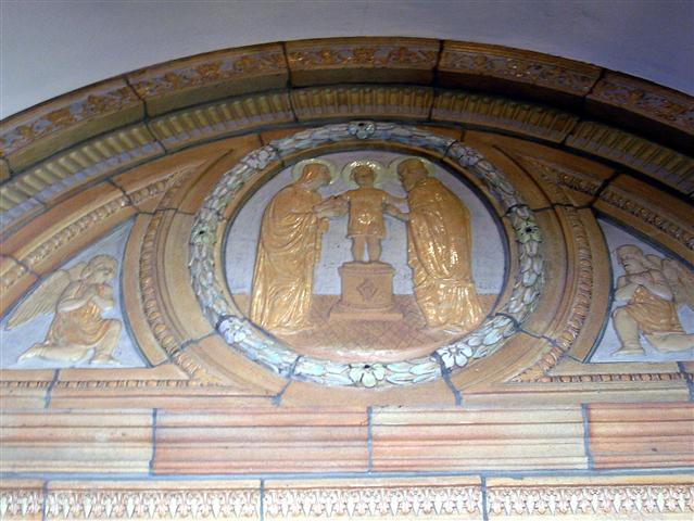 The early life of Christ is depicted in relief in six terra cotta medallions in the narthex of the church. Here we see The Presentaton of the Child Jesus in the Temple (Luke 2:22-40) The Feast of the Presentation is celebrated on February 2. Photo credit: Margaret Dick.