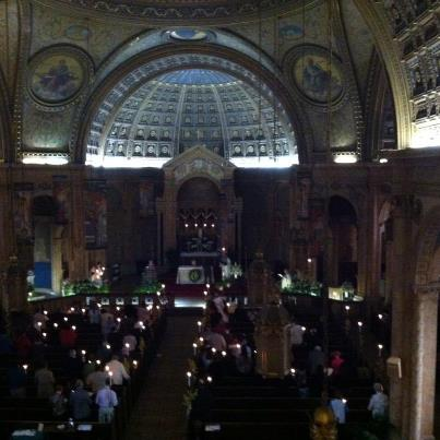 """The Easter Vigil Service, during the singing of the The Easter Proclamation or """"Exsultet,"""" by Bridget Blesnuk. Photo credit: Bonnie Hodur Williams."""