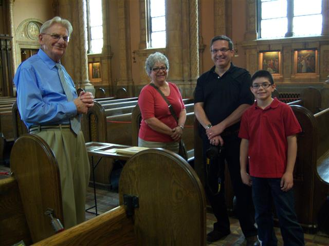Docent Terry Gress (left) gives a visiting family his unique perspective on the nave and dome during Sunday's Sacred Sites Open House.