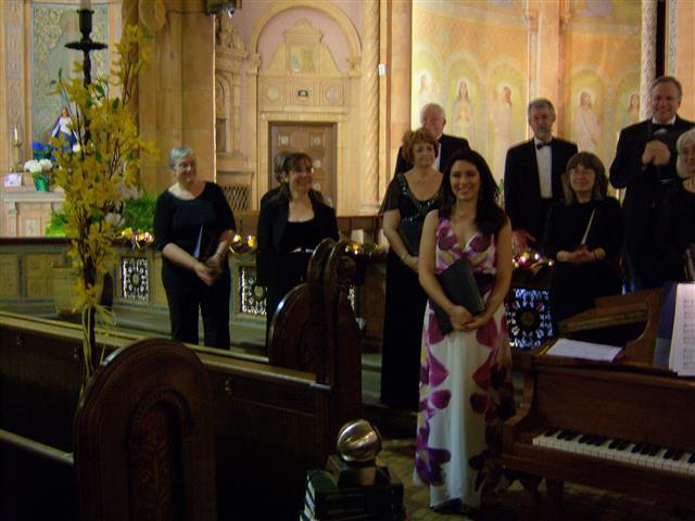 Members of The Freudig Singers, including BT choir members Elizabeth Sands (2nd from left) and Luis Clay (upper right) adknowledge audience applause at the end of their concert on May 3. Photo credit: Margaret Dick
