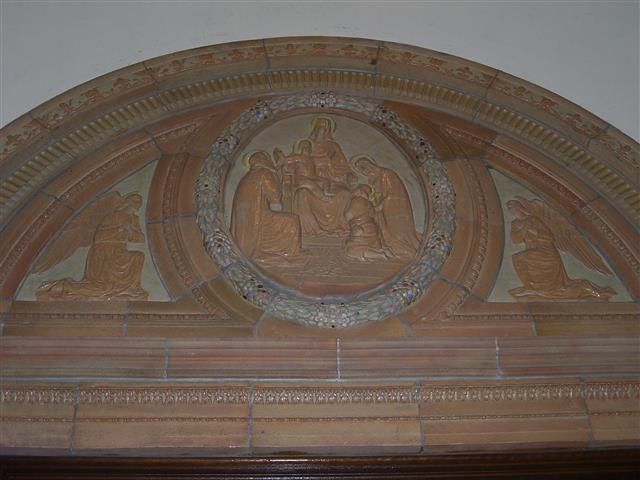 """Adoration of the God-Man,"" depicted in a large terra cotta relief in the church's narthex, over the center front door ~ Scripture does not record the childhood meeting of Jesus and his cousin, John, but ""it was a frequent medieval and Renaissance subject."" (Rev. Walter Kern's ""Guidebook to Blessed Trinity R. C. Church,"" page 18).  On June 24, the Church celebrates the Nativity of St. John the Baptist.  Photo credit: Margaret Dick"