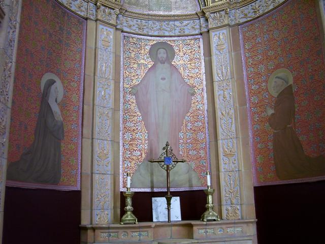 "Blessed Trinity's Sacred Heart altar features this mural representing Christ as ""a totally loving Person. The exposed Heart is merely the symbol of this insight and an invitation to return love for love.""(Rev. Walter Kern's Guidebook to Blessed Trinity Roman Catholic Church, page 28)."