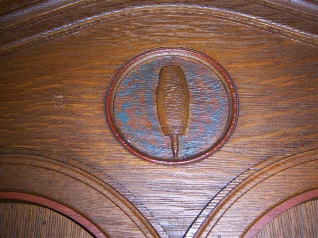 This week we celebrate Labor Day, and so we feature the woodcarvings in the rear of the church which honor the trades. This shoemaker's awl is one of six symbols carved on the doors of the large wooden cabinet designed as the ushers' office. All of the building's original woodcarvings were done by two brothers from Bowmansville, NY, Richard and Albert Lippich. (Rev. Walter Kern's Guidebook to Blessed Trinity R. C. Church, pages 23 & 24. Photo credit: Margaret Dick).