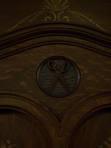 The scissors represent the seamstress or tailor.