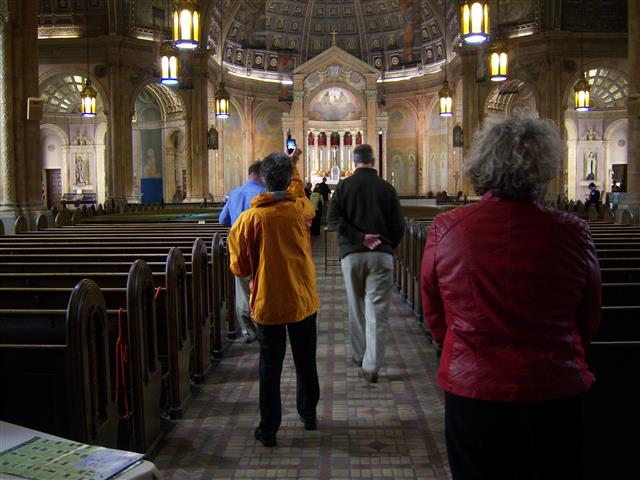 "Just a few of the tourists who visited during Doors Open Niagara. The ""wow"" effect upon entering the nave always starts the cameras clicking. Photo credit: Margaret Dick."