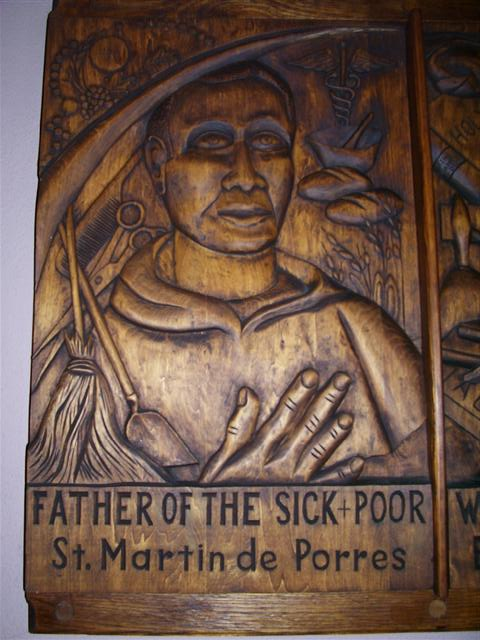 Woodcarving of St. Martin de Porres in the church's left transept. A gift of the Southtowns Woodcarvers.