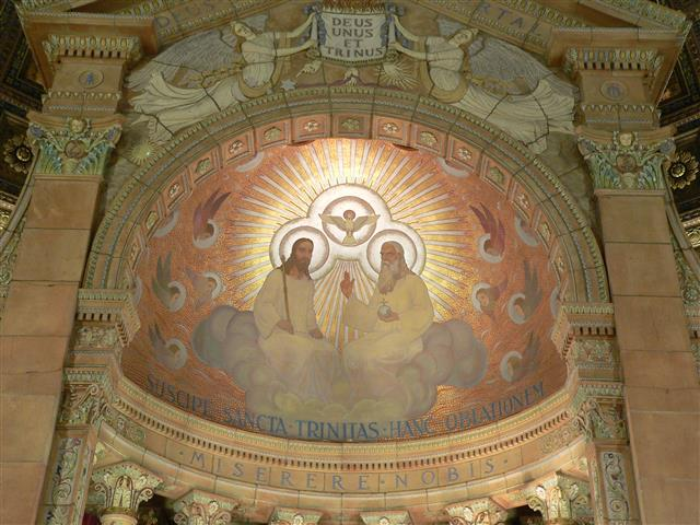 Depiction of the Blessed Trinity in our church's baldachino. Photo credit: Gary Kelley