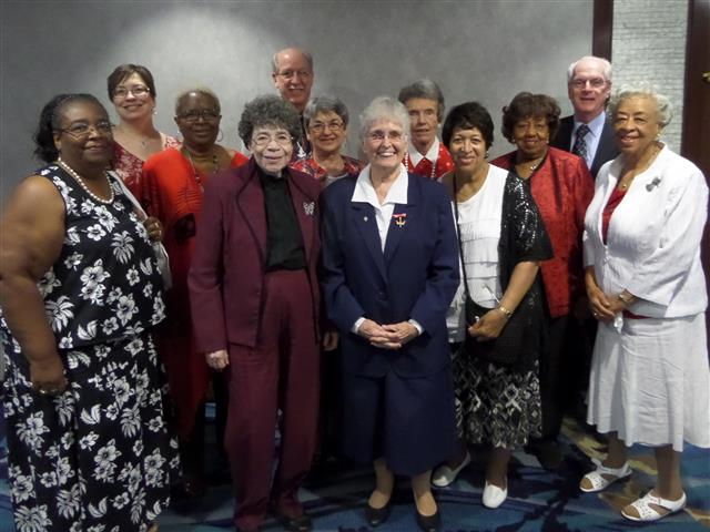 Sr. Claire Edwards, center, joined by parishioners at diocesan tribute to Daughters of Charity.
