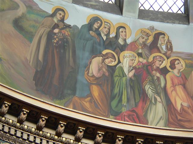 This week includes the feast days of two holy women who are depicted in Joseph Mazur's procession of saints in the church dome. St. Elizabeth (November 17) who was the daughter of the King of Hungary wears a crown and appears as the second standing figure from the right. St. Cecilia (November 22), patron saint of musicians, is the kneeling figure at the far right. Photo credit: Gary Kelley.