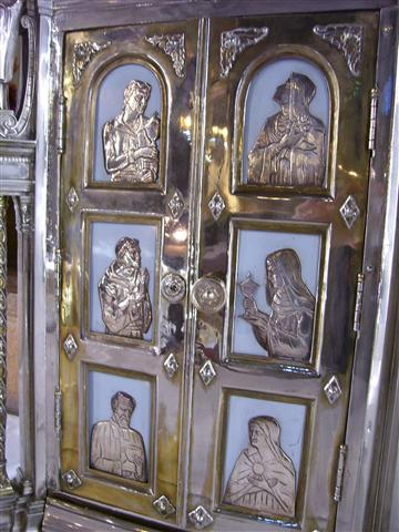 St. John Vianney, whose feast the Church celebrates on August 4, is one of six saints associated with the Eucharist or the offering of sacrificial gifts who is depicted (bottom left) in silver relief on the doors of our Tabernacle. Photo credit: Margaret Dick