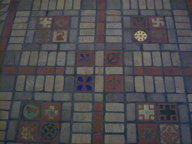 Detail from ceramic tile floor of Blessed Trinity Church: In addition to the 556 tiles depicting 24 different kinds of crosses, tiles pictured here feature an elephant (a symbol of Christ and the first man and woman), the Polish Falcon (love of one's county); and a fish (another symbol of Christ or the month of February).