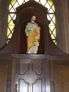 Statue of St. Joseph and hand carved cabinetry in Daily Mass Chapel.