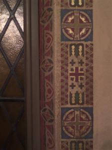 Decorative stenciling surrounds the windows in our Daily Mass Chapel.