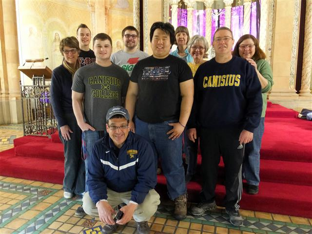 "Even though their students are on a semester break, our friend Joe Van Volkenberg from Canisius College Campus Ministry still turned out a team of administration and student volunteers to help parishioners clean the church for Mass Mob IX. Joe Van Volkenberg (kneeling) is joined by his team of Canisius College volunteers in the Sanctuary of Blessed Trinity Church; left to right: Kathleen Delaney, Jonathan Christen, Jake Iannuzzelli, Mike Moeller, Joe (""AJ"") Kwiatkowski, Ruth Coleman, Patty Grasso, Patrick Burke, and Dr. Terri Mangione."