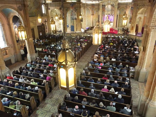 Approximately 650 attended Sunday Mass at Blessed Trinity on on March 22, 2015 as part of Mass Mob IX.