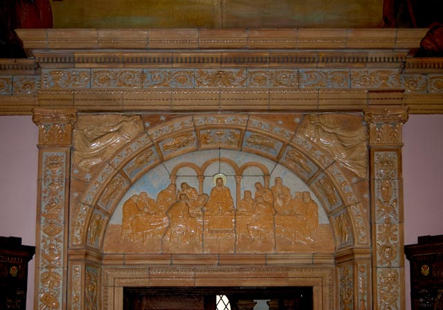 """Jesus said to them, 'I am the bread of life; whoever comes to me will never hunger, and whoever believes in me will never thirst'."" John 6:35 P. Kuhnle's ceramic sculpture of the Last Supper over the inside door in Blessed Trinity's Right (West) Transept. Photo credit: Steve Mangione"