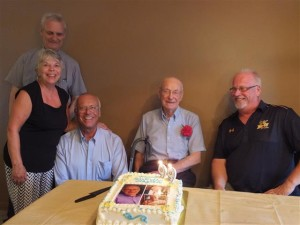 Clate Steinwachs celebrates his 99th birthday with daughter, Ann, and sons David, Tom & Joe.