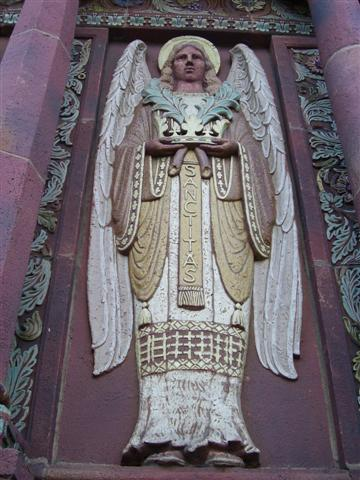 One of four angels on the church facade symbolizing the Four Marks of the Church: One, Holy [Sanctitas], Catholic, and Apostolic.