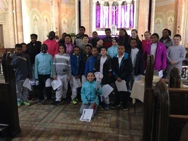 "Fifth and sixth-grade students from St. Joseph University School visited Blessed Trinity Church on March 10 to learn more about local architecture. They even brought along ""Flat [Pope] Francis."""