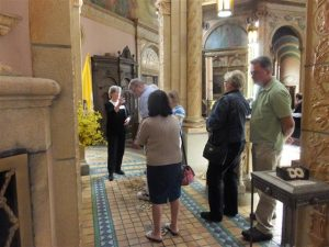 Visitors try to take it all in as docent Nancy Yager interprets the symbols about the Sacred Heart altar.