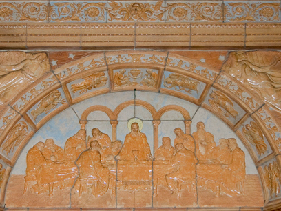 Detail of P. Kuhnle's ceramic relief of the Last Supper over the doorway in the right (west) transept. Photo credit: Steve Mangione