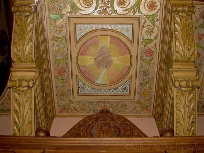 Symbolic artwork on underside of choir loft. Photo credit: Char Szabo-Perricelli