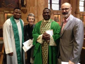 Rev. Victor Ibhawa, 2nd from right,with parishioners and Rev. John Aligamhe on Nov. 6.